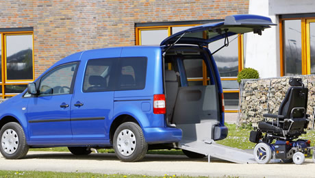 blue volkswagen with wheelchair access ramp servicing